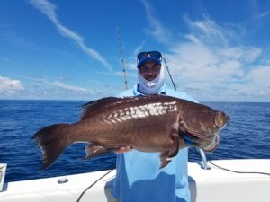Happy customer with a BIG FISH caught with Rigged & Ready Holden Beach Fishing Charters